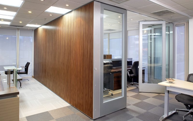 Series AP 100 Veneered Movable Acoustic Wall Panels & GS100 Double Glazed Movable Wall Panels In The Same L-shaped Opening